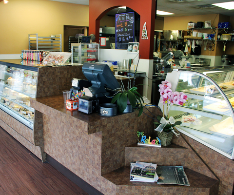 The inside of U Knead Sweets is simple and filled with cake, cookies and treats for all tastes.