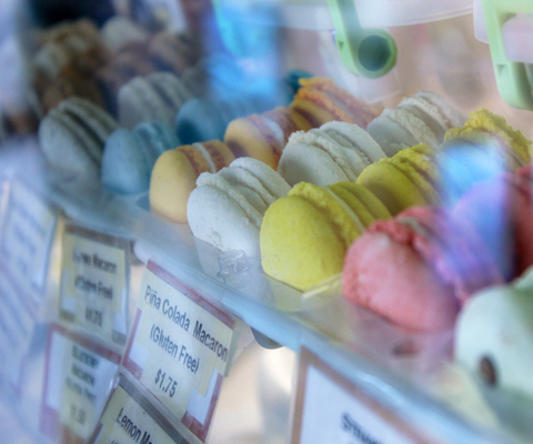 Colorful macaroons ranging in flavors from green tea to strawberry shine in the U Knead Sweets window.