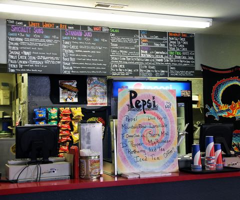Sub Shop's colorful atmosphere and menus are a change of pace from the traditional sandwich shop