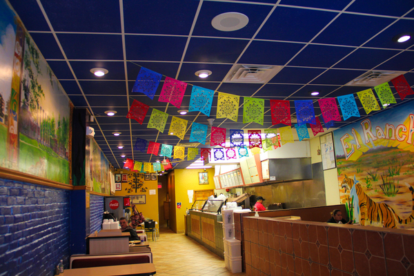Brightly colored decorations hang from the ceiling of El Rancho in downtown Columbia, MO
