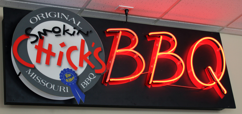 A personalized neon BBQ sign adorns the walls of Smokin' Chicks.