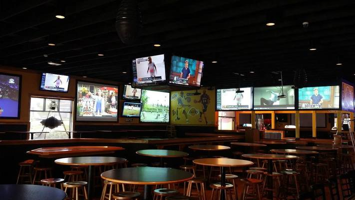 Many flatscreen TVs and open seating at Southside