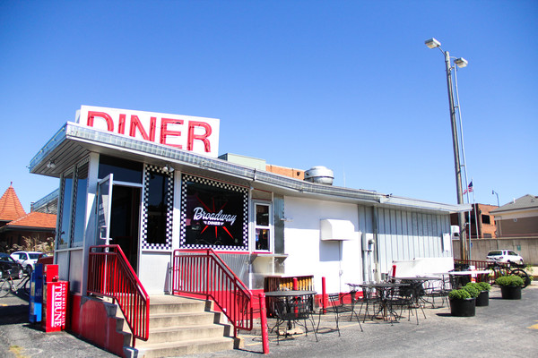 The outside of The Broadway Diner is small but quaint, having the feel of a classic 50s diner with expansive parking.
