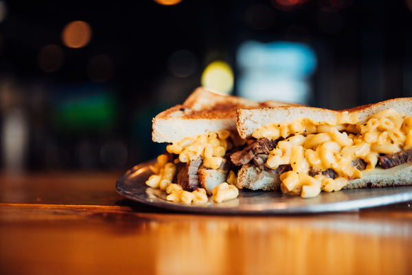 Como Smoke and Fire's brisket sandwich loaded with meat and mac-n-cheese on toast.